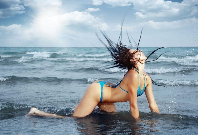 Sexy lady in bikini at the summer beach