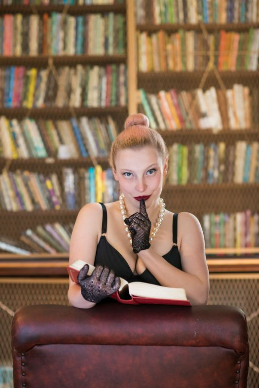 Beautiful caucasian woman being kinky in old library