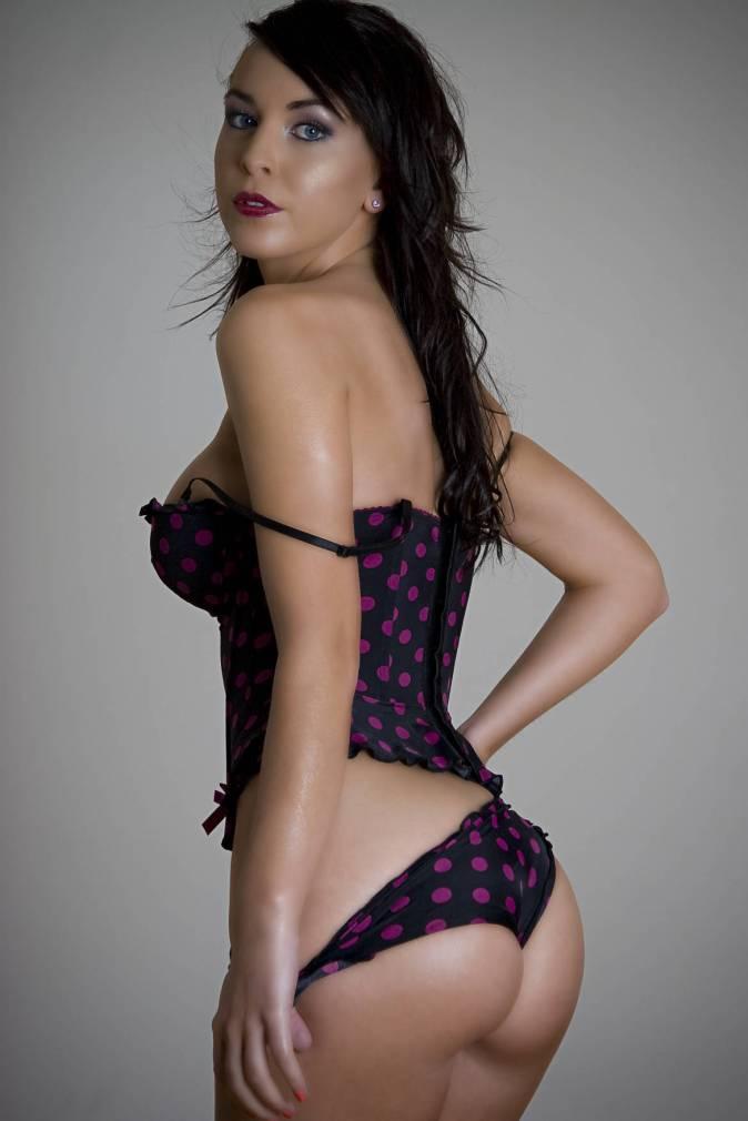 young twenty something women in pokedot lingerie lowering her panties
