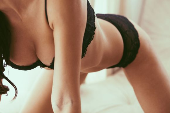 Boudoir photo of sexy girl wearing stylish black lingerie underwear, soft focus