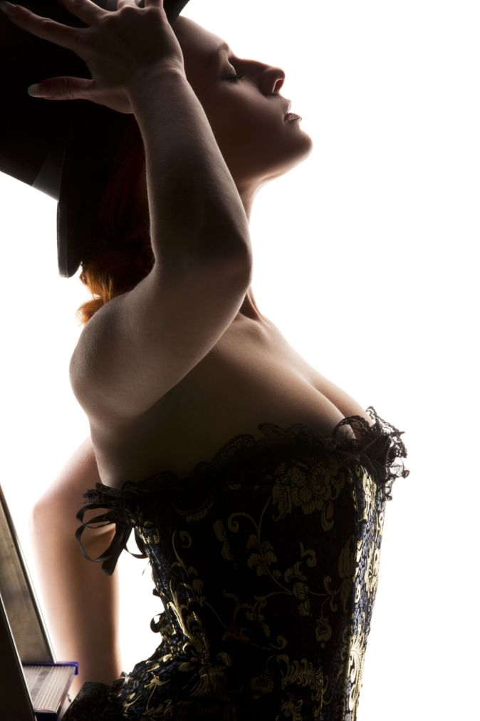 silhouette backlight picture of sexy woman with ladder