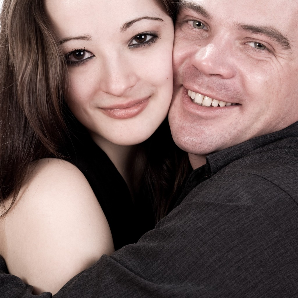 woman half smiling and man smiling